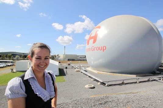 Enthusiastic young woman proudly drives world-first green energy plant